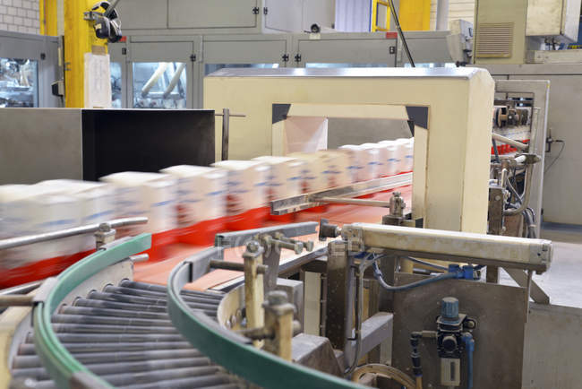 Production line with refined sugar in a factory — Stock Photo