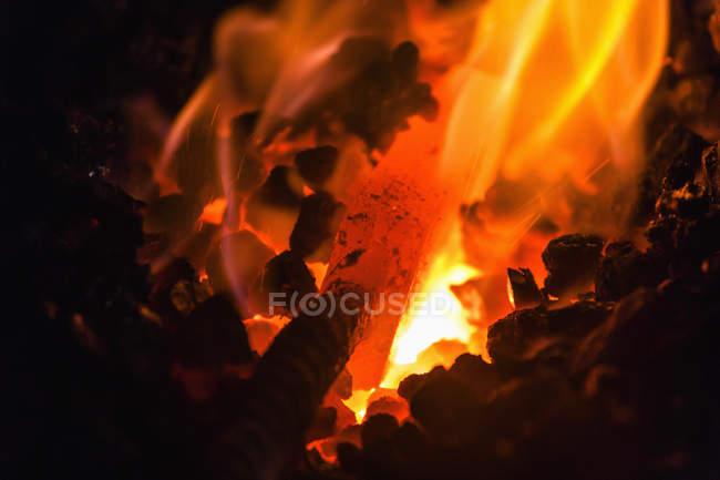 Knife work piece in blacksmith fire — Stock Photo