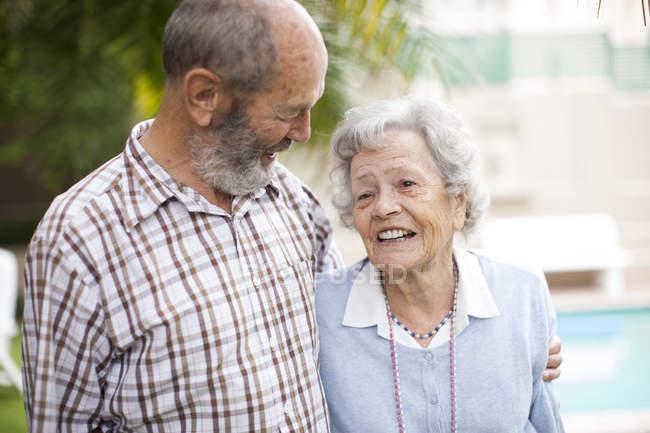 Happy senior couple in a retirement village — Stock Photo