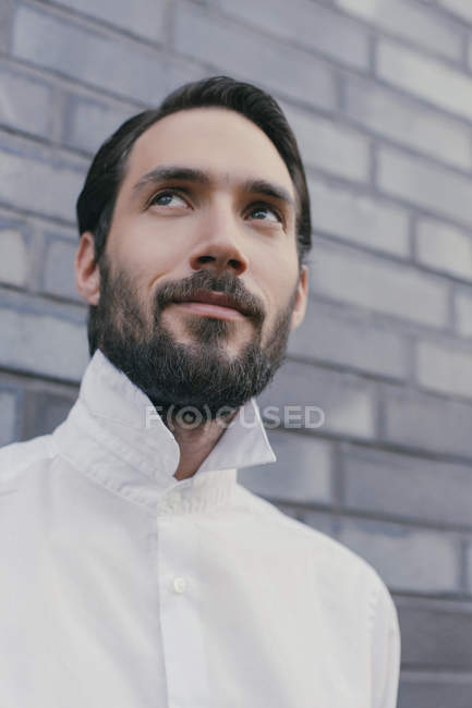 Portrait of young bearded man wearing white shirt — Stock Photo