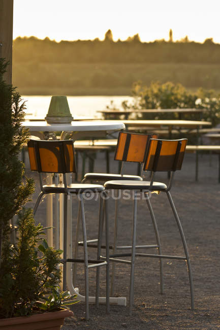 Saxony, empty chairs in a beer garden at evening twilight — Stock Photo