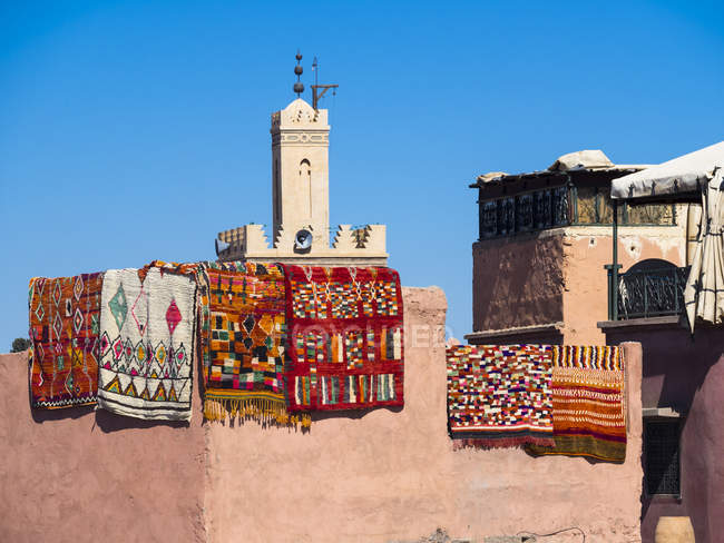 Morocco, Marrakech, colorful traditional Carpets hanging on building — Stock Photo
