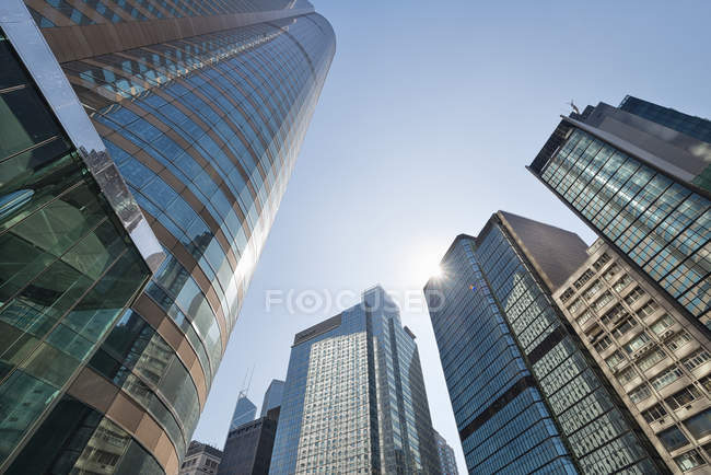 China, Hong Kong, Wolkenkratzer im Gegenlicht im Downtown, Central — Stockfoto