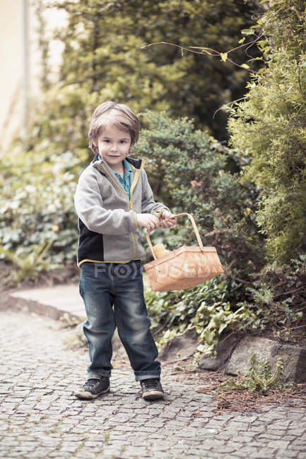 Little boy with basket on the move at daytime — Stock Photo