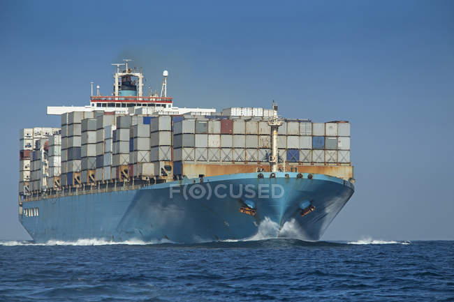 Spain, Andalusia, Tarifa, Container ship over water — Stock Photo