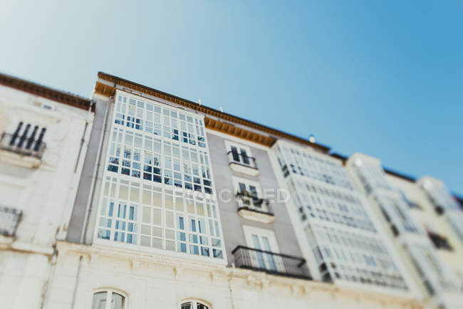 Spain, Burgos, facade of multi-family house, view from below against sky — Stock Photo