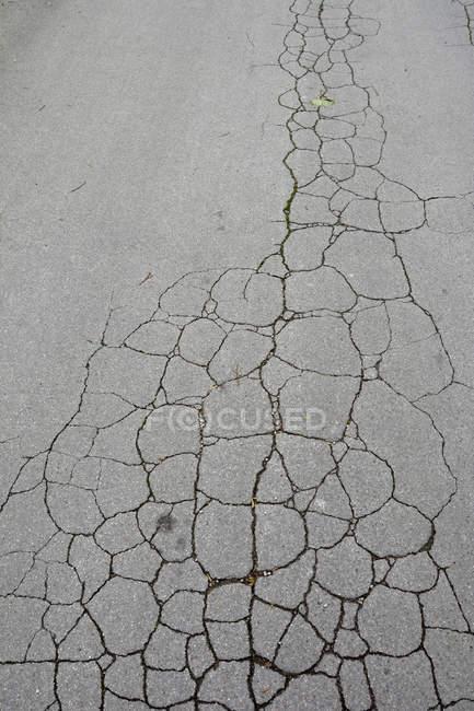 Cracked asphalt street top view — Stock Photo