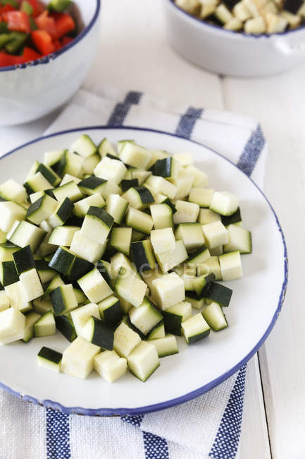 Bowl of diced courgettes — Stock Photo
