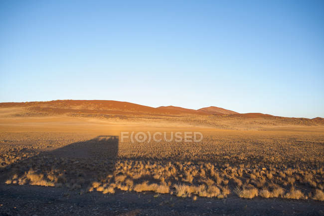Africa, Namibia, Sossusvlei, Shadow of a car and sand dunes  during daytime — Stock Photo
