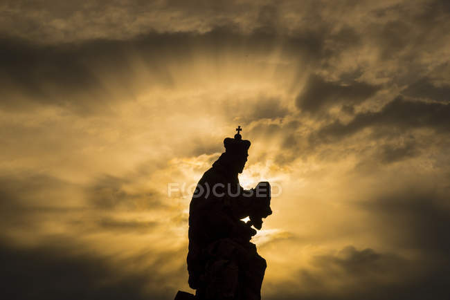 Czechia, Prague, view to statue of Ludmila of Bohemia at Charles Bridge by twilight — Stock Photo