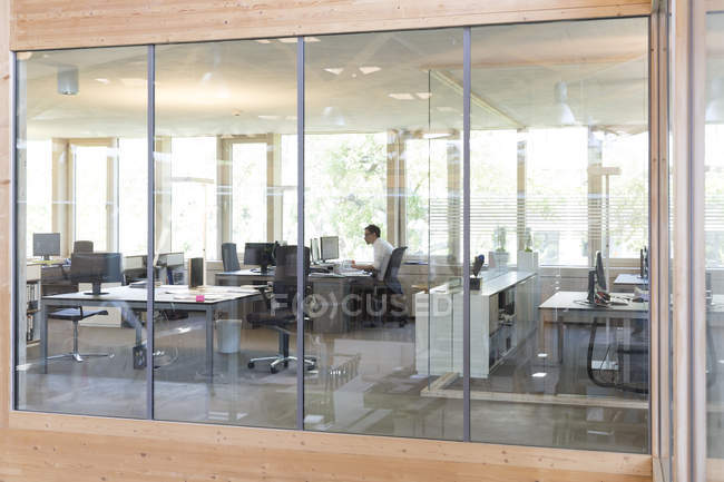Business man at workplace in modern office — Stock Photo