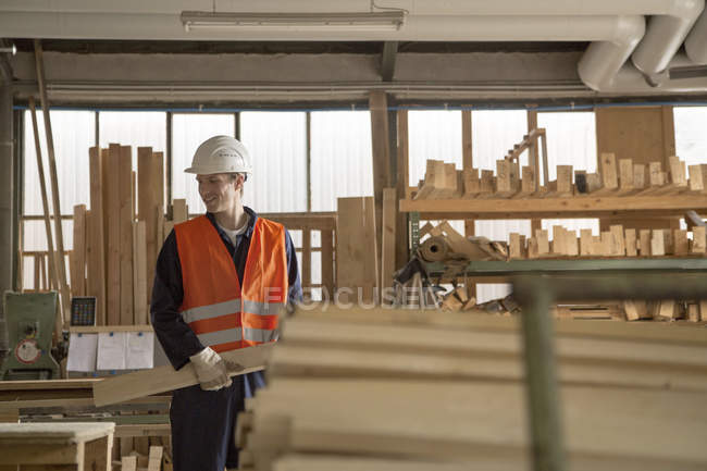 Young worker at carpentry of pallet production — Stock Photo