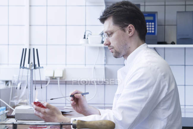 Portrait of food analyst working in laboratory — Stock Photo