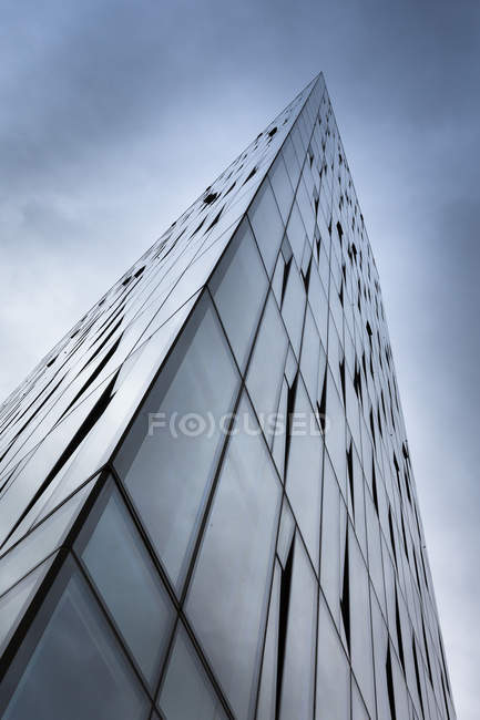 Island, Reykjavik, glass facade of office building, view from below — Stock Photo