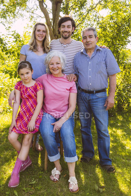Portrait of three generation family in garden — Stock Photo