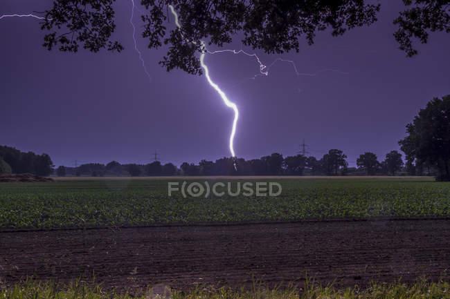 Germany, Lower Saxony, Handorf, lightning strike on the countryside at night — Stock Photo