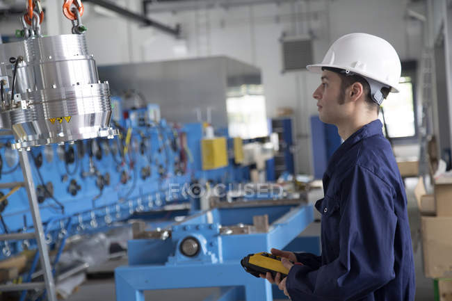 Technician in a factory building — Stock Photo