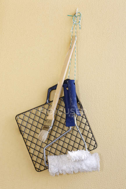 Painting tools hanging on wall — Stock Photo