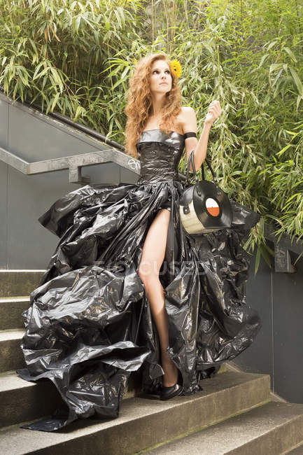 Woman wearing dress made from bin bags — Stock Photo