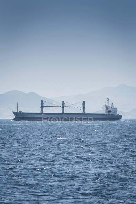 Spain, Andalusia, Tarifa, Strait of Gibraltar, Cargo ship over water — Stock Photo