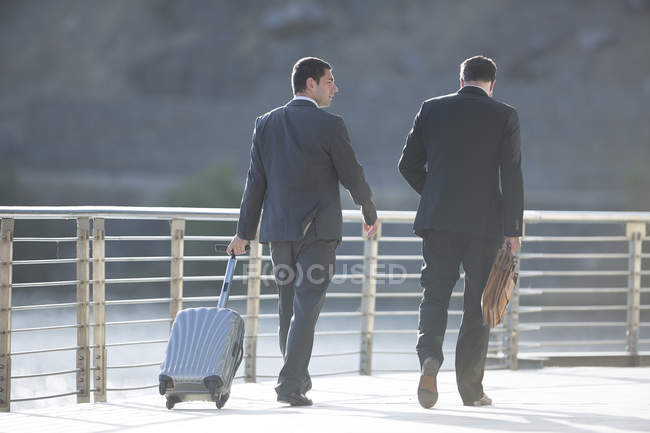 Businessmen on business trip walking together — Stock Photo