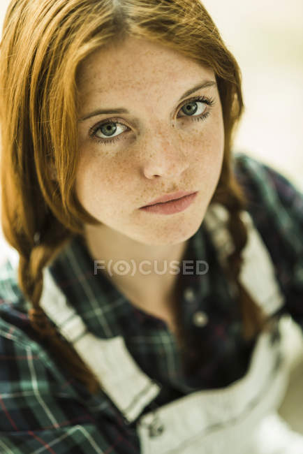 Portrait of redheaded young woman with feckles — Stock Photo