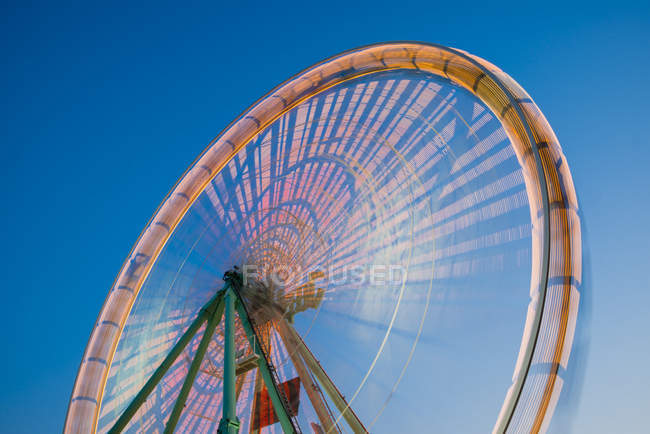 Germany, North Rhine-Westphalia, Cologne, part of lighted turning big wheel at blue hour — Stock Photo