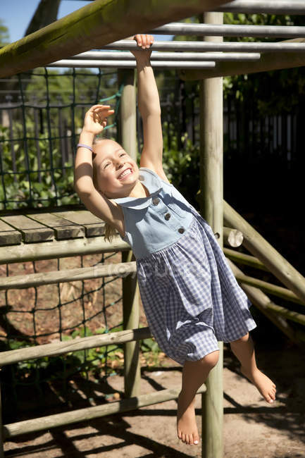 Little girl playing on playground — Stock Photo