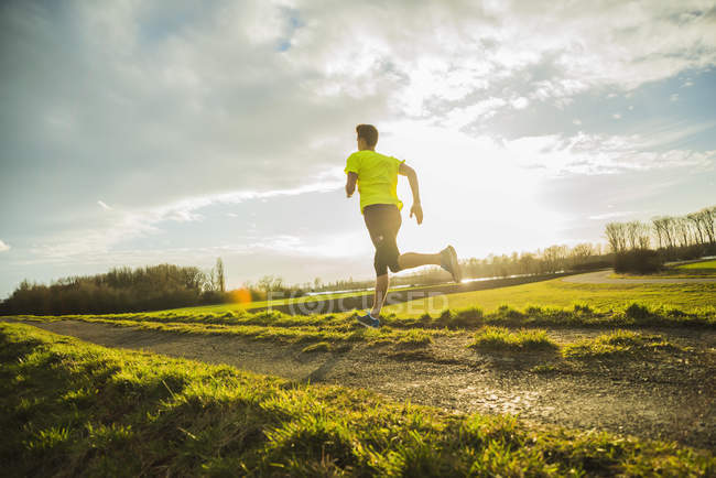 Germany, Mannheim, young man jogging — Stock Photo