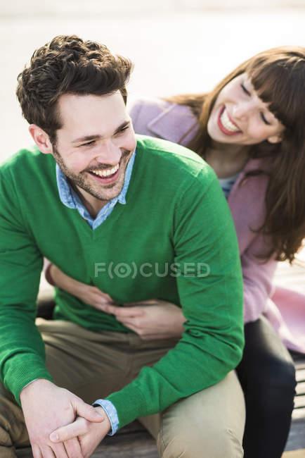 Happy couple embracing outdoor — Stock Photo
