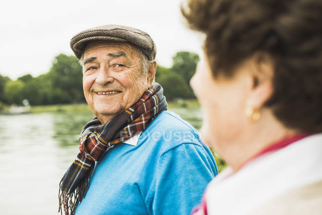 Portrait of smiling senior man face to face with his wife — Stock Photo