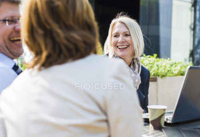 Female businesspeople having meeting at caferteria — Stock Photo