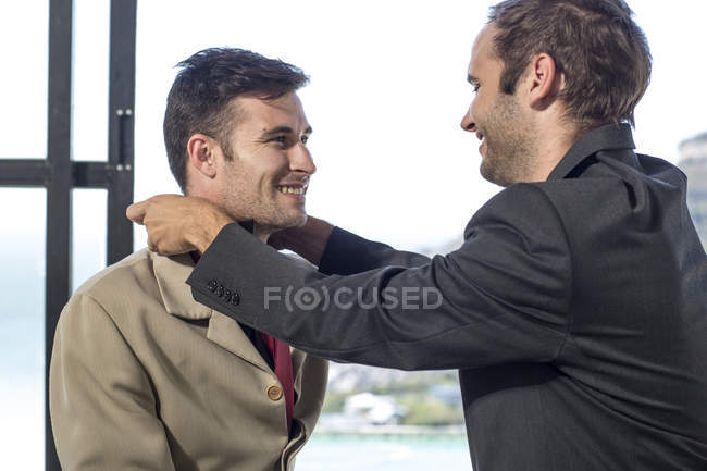 Gay couple getting ready for work — Stock Photo