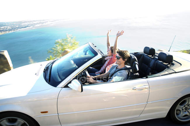 South Africa, happy couple in convertible on coastal road — Stock Photo