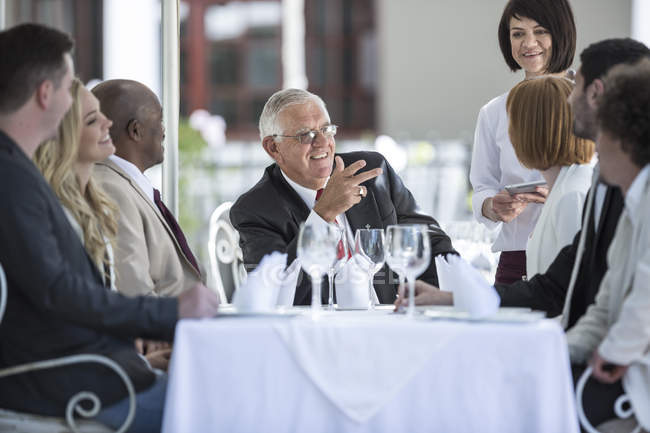 Business people having business lunch in restaurant — Stock Photo