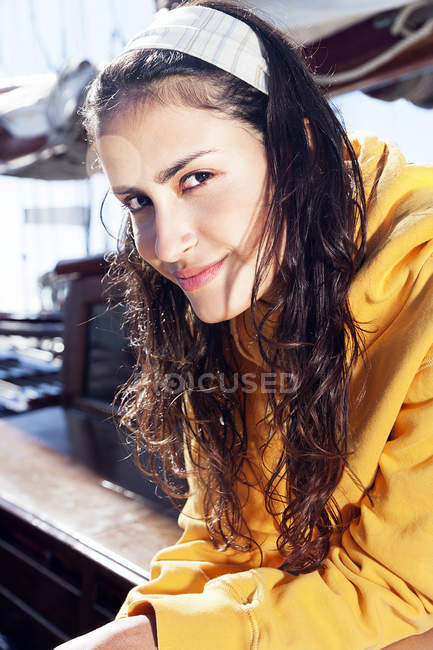 Portrait of smiling young woman on a sailing ship — Stock Photo
