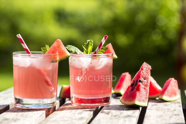 Watermelon-Hugo, Mojito in glasses with drinking straws — Stock Photo