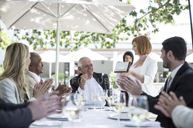 Businesspeople celebrating achievements in restaurant — Stock Photo