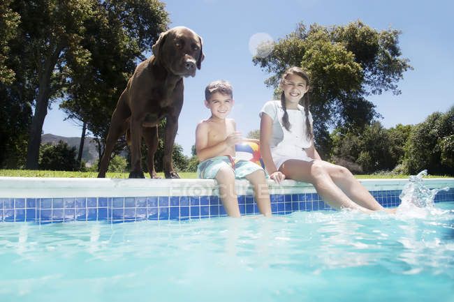 Brother and sister with dog — Stock Photo