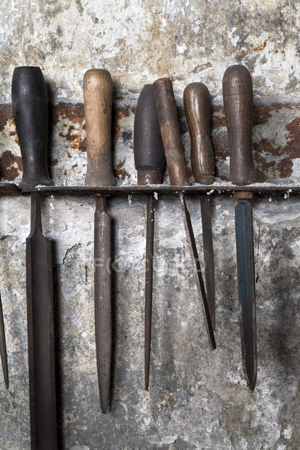 Germany, Bavaria, Josefsthal, fitting with six old metal files at historic blacksmith's shop — Stock Photo
