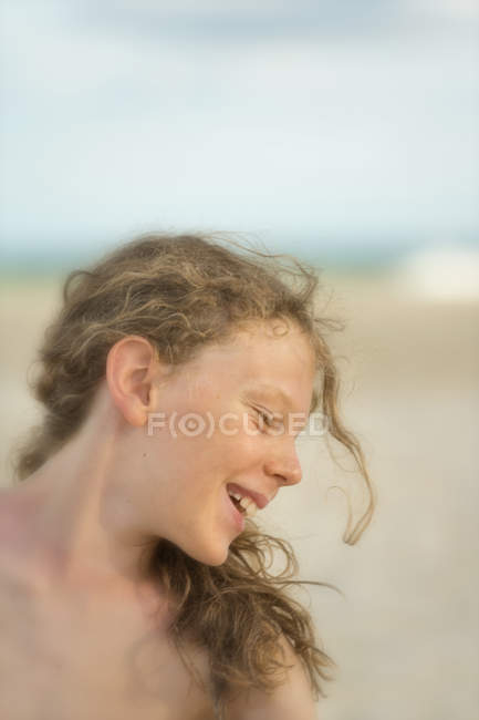 Australia, New South Wales, Pottsville, smiling boy with long hair on beach — Stock Photo