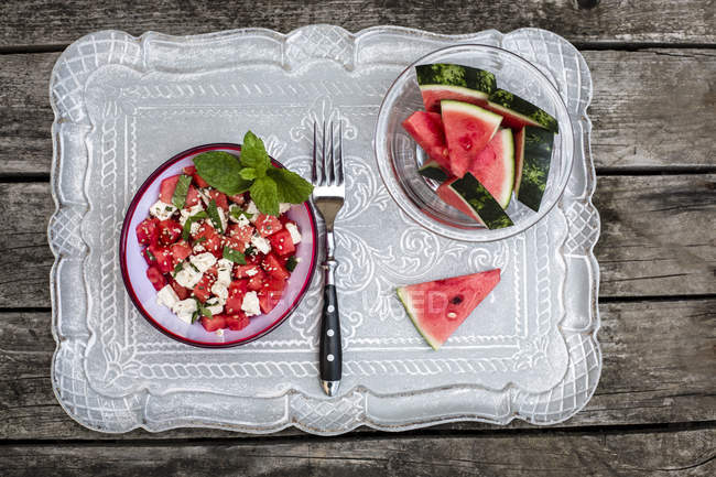Top view of fresh watermelon salad with feta cheese, mint and sesame — Stock Photo