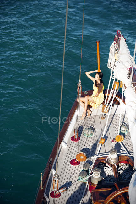 Young woman on deck of a sailing ship — Stock Photo