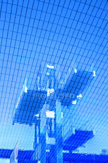 Water reflection of highboard at swimming pool — Stock Photo