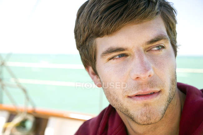 Portrait of young man on a sailing ship — Stock Photo