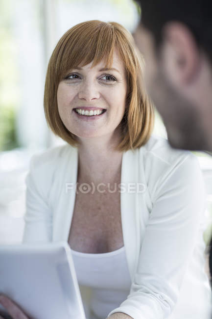 Businesspeople discussing work at business lunch — Stock Photo