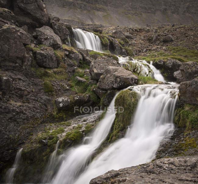 Dynjandi waterfall by rocks — Stock Photo