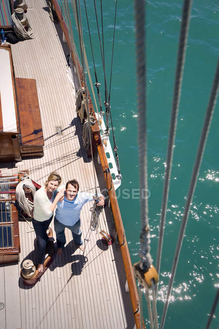 Mature couple on deck of a sailing ship — Stock Photo