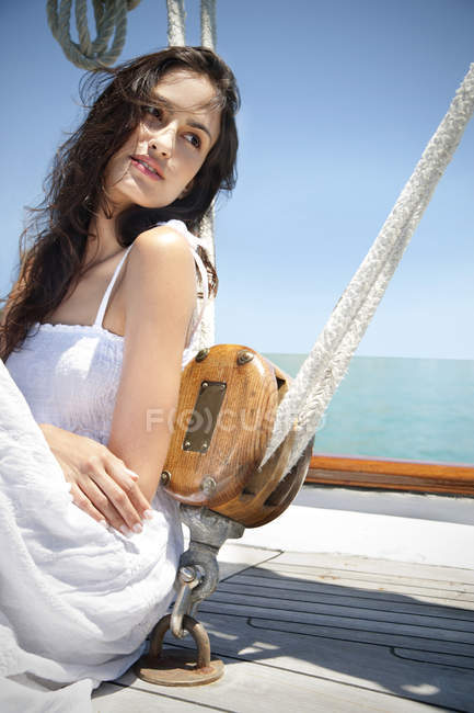 Brunette young woman on a sailing ship — Stock Photo