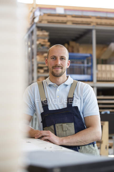 Smiling craftsman on shop floor — Stock Photo